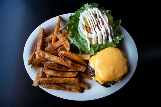 University Library Café's Library Burger, $7.99. A cheeseburger with lettuce, tomato, onions, pickles and mayo.