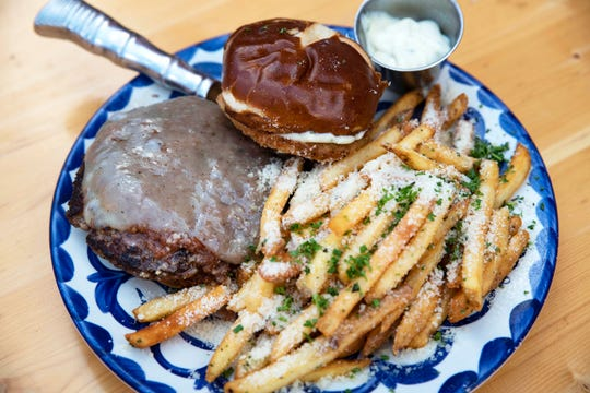 Exile Brewing Company's Exile Burger, $15. Ground chuck, Ruthie onion bacon jam, white cheddar, an onion haystack, and truffle aioli.
