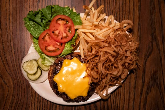 Maxie's Restaurant & Lounge's half-pound Maxieburger, $10.95. Toasted bun with lettuce, tomato, onion and dill pickle, with French fries and award-winning, handmade onion rings.