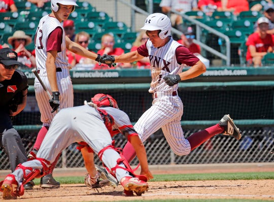 Jake Hilmer of North Linn beats the tag as he crosses home plate in a Class 2A quarterfinal against West Branch on Monday, July 29, 2019, at Principal Park in Des Moines.