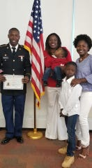 Iowan Chris Masakah, left, a member of the U.S. Army Reserves, celebrates becoming a citizen. Masakah died July 26 in a drowning accident in Arizona.
