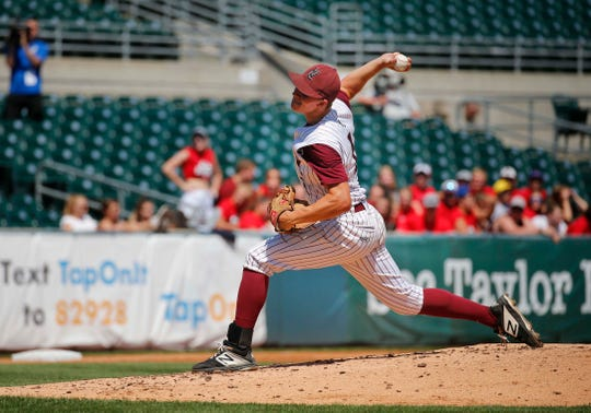Jake Hilmer of North Linn pitches in the state semifinal game against West Branch Monday, July 29, 2019.