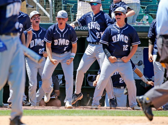 Des Moines Christian players celebrate a run in the state baseball semifinal Monday, July 29, 2019.