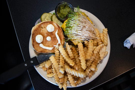 Ankeny Diner's California Burger, $8.59. A broiled burger with onion, mayo, pickle, avocado, sprouts and optional cheese.