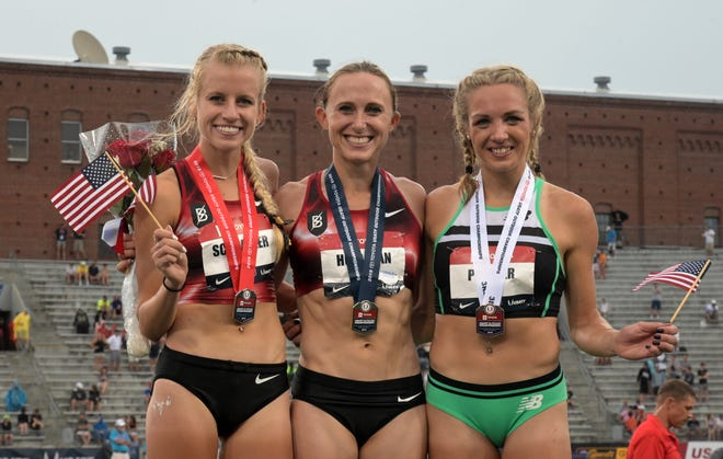 Women's 5,000 meters winner Shelby Houlihan (center) poses with runner-up Karissa Schweizer (left) and third-place finisher Elinor Purrier at the USATF Championships at Drake Stadium on Sunday, July 28, 2019, in Des Moines.