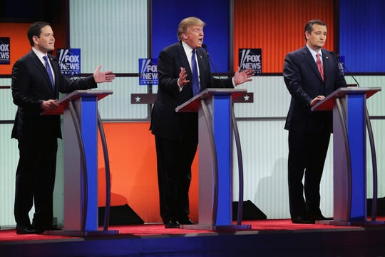 Republican presidential candidates (Lto R) Sen. Marco Rubio (R-FL), Donald Trump and Sen. Ted Cruz (R-TX) participate in a debate sponsored by Fox News at the Fox Theatre on March 3, 2016, in Detroit, Michigan.