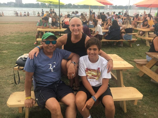 Dado, 57, Shannon 52, and Anthony Franco, 15, of Shelby Township attend the Mo Pop Festival at West Riverfront Park Sunday, July 28, 2019.