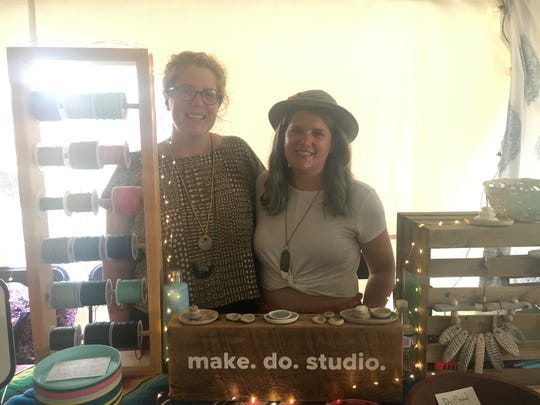 Katie Bramlage and her sister, Jenny Jackson, are one of the art vendors at  the Mo Pop Festival at West Riverfront Park Sunday, July 28, 2019.