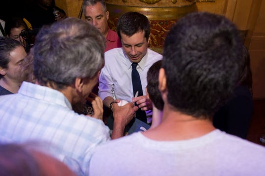 Democratic presidential candidate Pete Buttigieg signs autographs during a campaign event at the Fillmore Theater in Detroit on Sunday, July 28, 2019.