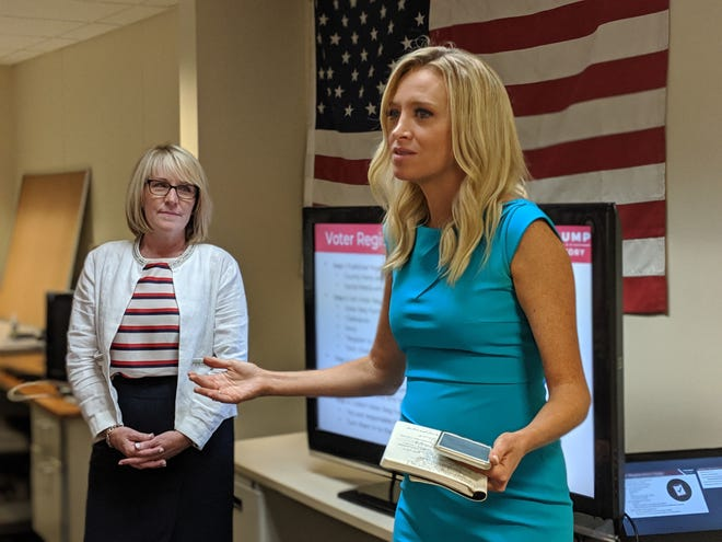 Kayleigh McEnany, national press secretary for the Trump campaign, talks to volunteers at Michigan Republican Party headquarters on July 29, 2019.