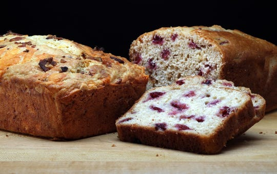 Summer quick breads are seen in the Tribune studio on Wednesday, July 3, 2019. Left, with bacon and cheese, and, right, with cherries and almonds. (Terrence Antonio James/Chicago Tribune/TNS)