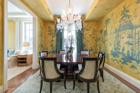 A hand-painted mural adds an unexpected artistic touch to this dining room.