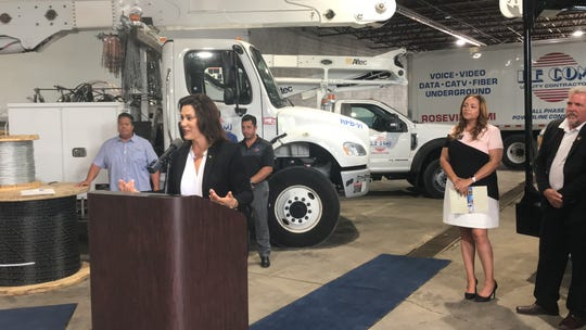 Gov. Gretchen Whitmer announces a plan to prioritize Michigan contractors at LeCom Utility Contractors in Roseville, Monday.
