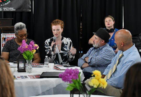 Clare Garvie, senior associate from Georgetown's Center on Privacy & Technology (with microphone) speaks at a town hall meeting discussing the use of facial recognition software by law enforcement in Detroit at Historic King Solomon Baptist Church in Detroit on July 29, 2019.