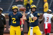 """I think it's fun,"" says Dylan McCaffrey (10), here with starter Shea Patterson (2), about Michigan's two-quarterback system."