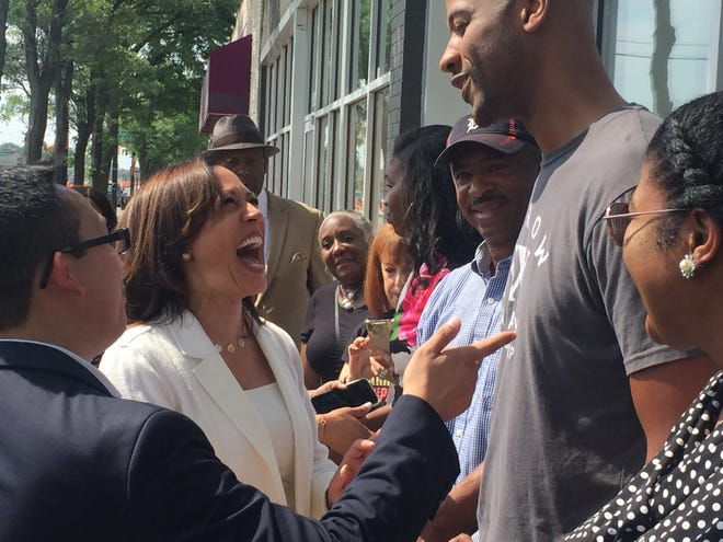 U.S. Sen. Kamala Harris, D-California, shares a moment Monday (July 29, 2019) with Jonathan Merritt, owner of the Narrow Way Cafe and Shop in Detroit. The Democratic presidential hopeful visited a cafe and bakery along Livernois Avenue in northwest Detroit ahead of her Wednesday presidential debate at the Fox Theatre.