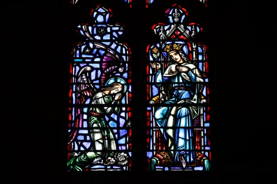 This Friday, June 7, 2019 photo shows stained glass windows at The Assumption of the Blessed Virgin Mary Church in Detroit.