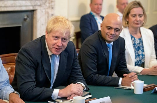 Britain's newly appointed Prime Minister Boris Johnson, left, with Chancellor of the Exchequer Sajid Javid and Secretary for Work and Pensions Amber Rudd, has vowed to see through Brexit.