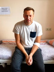 This Monday, July 29, 2019 handout photo released by navalny.com shows Alexei Navalny, Russia's most prominent opposition figure, sitting on a bed in a hospital, in Moscow, Russia. Russian opposition leader Alexei Navalny was discharged from a hospital Monday even though his physician raised suspicions of a possible poisoning after he suffered facial swelling and a rash while in jail.