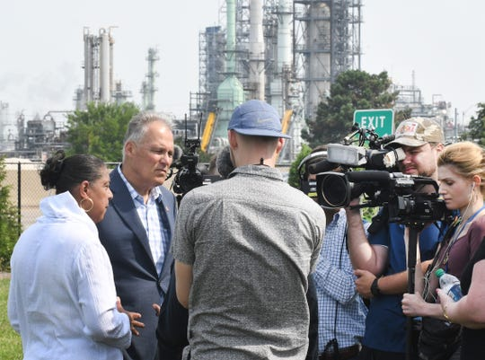"Washington Governor and Democratic presidential candidate Jay Inslee holds a press conference to introduce his ""Community Climate Justice"" plan across the highway from the Marathon Oil refinery, in Detroit, Michigan on July 29, 2019."