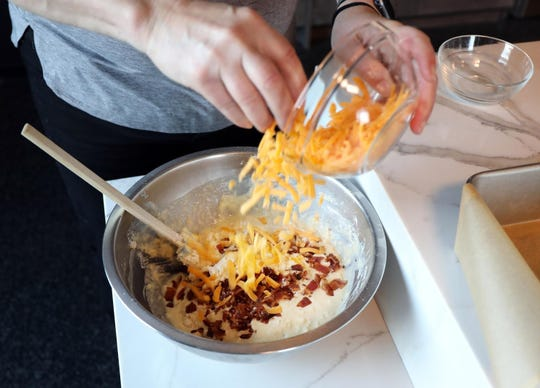 The ingredients for a summer quick bread (this one with cheese and bacon) are lightly mixed on Wednesday, July 3, 2019. (Terrence Antonio James/Chicago Tribune/TNS)