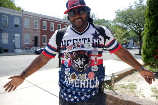 Victor Toulson, 50, displays his patriotic shirt outside of the Sandtown-Winchester Senior Center, Monday in the Sandtown section of Baltimore.