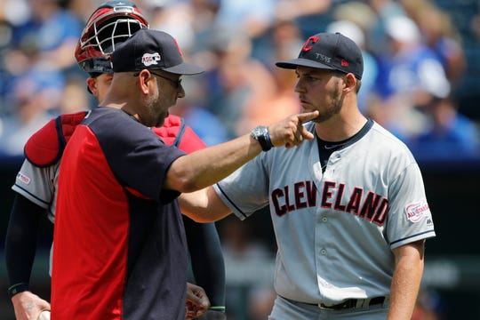 Indians manager Terry Francona, left, has words with pitcher Trevor Bauer, right, as Bauer is taken out in the fifth inning on Sunday.