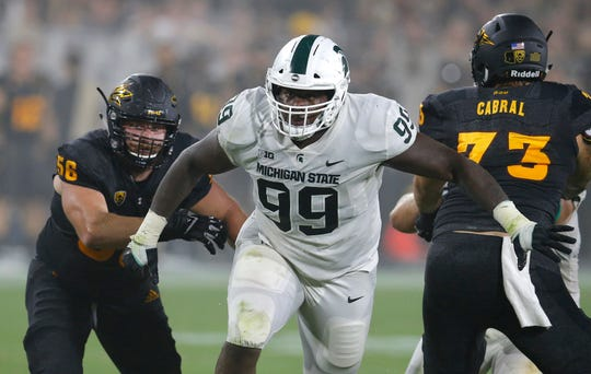 Michigan State defensive tackle Raequan Williams (99) returned to East Lansing for his final season so he could earn his degree.