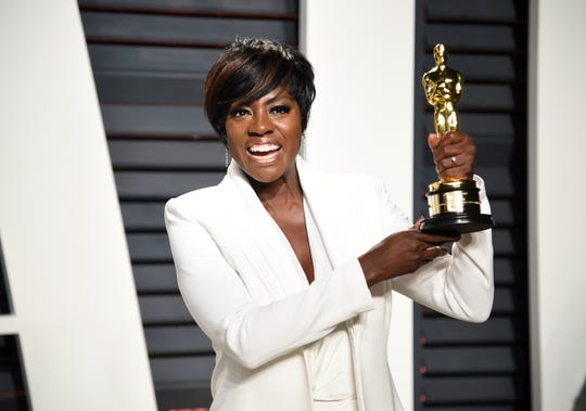 "Viola Davis holding her Oscar for best supporting actress for role in ""Fences"", at the Vanity Fair Oscar Party in Beverly Hills, Calif. on Feb. 27, 2017."