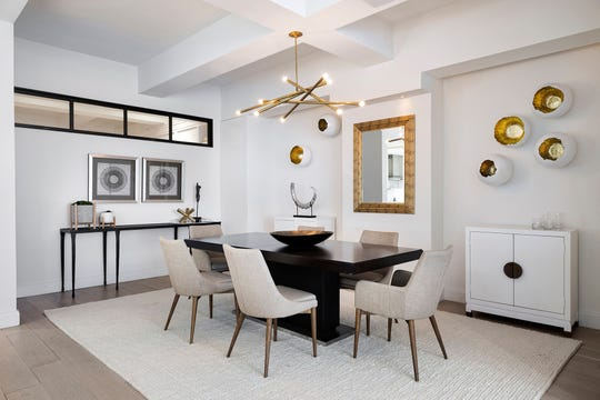 Three-dimensional sculptural art creates instant glam in this dining room. =