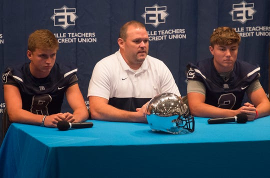 Reitz's Head Coach Andy Hape, center, answers question about the upcoming season with Owen O'Reilly, left, and Reid Brickey, right, during High School Football Media Day 2019 Monday, July 29, 2019.