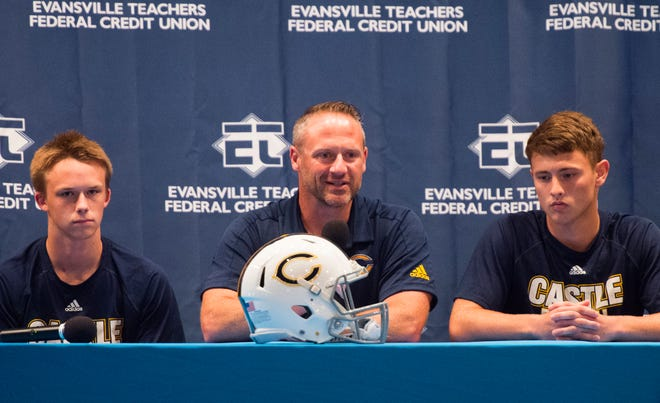 Castle's Head Coach Doug Hurt, center, answers questions about the upcoming season with Jasper Heubner, right, and Andrew Perry during High School Football Media Day 2019 Monday, July 29, 2019.