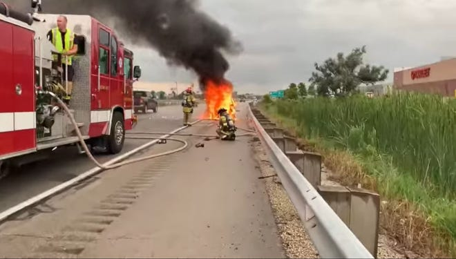 """Fond du Lac Fire/Rescue puts out fire in a """"smart car"""" on Monday July 29, 2019, on Interstate 41."""