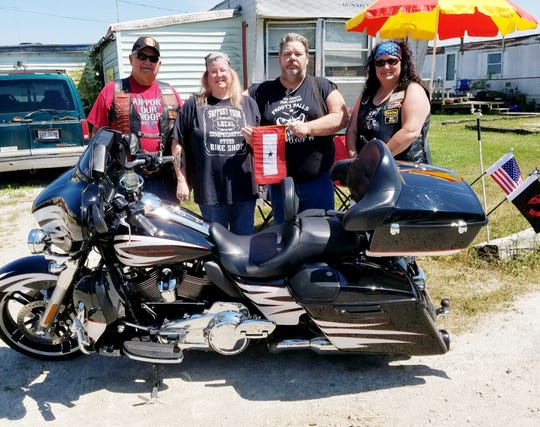 Bob Clark,  BLUE STAR BANNER Chairman of American Legion Riders  West Unity, Ohio Post 669 is with Anistatia Redecki, mother of the soldier; David Silverwood; and  Mary Below, Director of the American Legion Riders of Green Springs, Post 295.