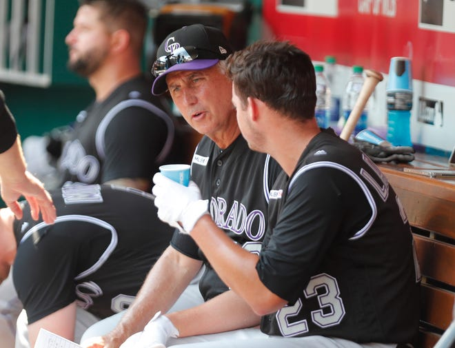 Colorado Rockies manager Bud Black, left, talks with pitcher Peter Lambert in the dugout during a game Sunday in Cincinnati. The Rockies play home games at 6:40 p.m. Tuesday and 1:10 p.m. Wednesday against the Los Angeles Dodgers at Coors Field in Denver.