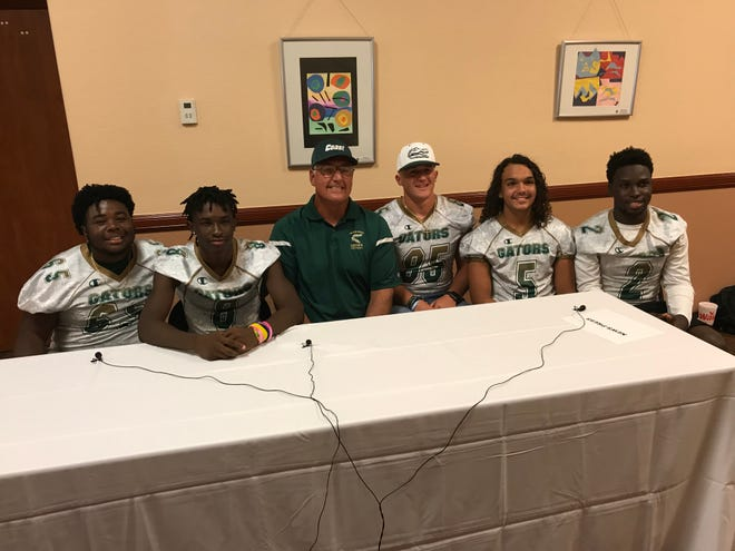 Island Coast was represented on Day 1 of Lee County Football Media Day Monday by Mathis Wright, Willie Brown, head coach Jim Wiseman, Brady Porvaznik, Jordan Smith and Jason Joesph