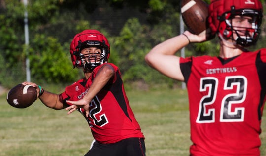 Evangelical Christian School quarterback R.J. Rosales runs drills with teammates during practice on the first day of football practice for High Schools on Monday July, 29, 2019. He is a transfer from Immokalee High School.