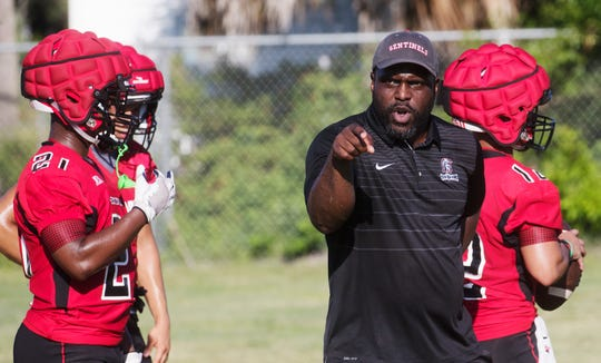 Evangelical Christian School coach Earnest Graham calls a play during  practice on the first day of football practice for High Schools on Monday July, 29, 2019.