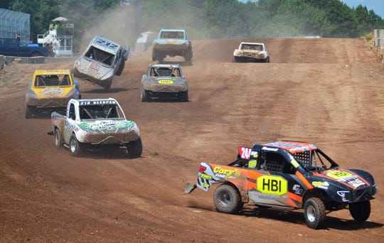 Racers in the junior mod carts division complete a lap Sunday in the Dirt City Duel off-road races at Lena.