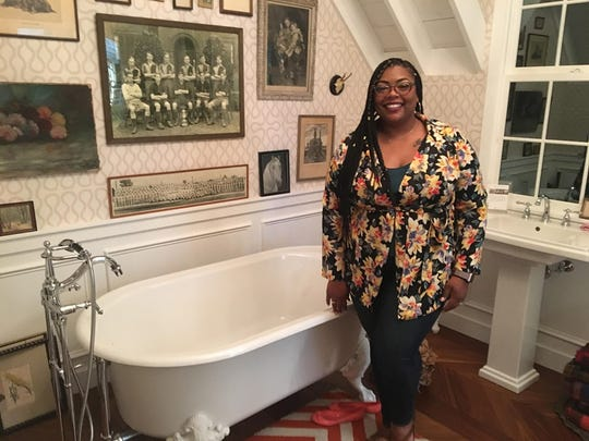 Alecia Mack in one of the prototype rooms the Kohler Design Center displays. She designs bathtubs.