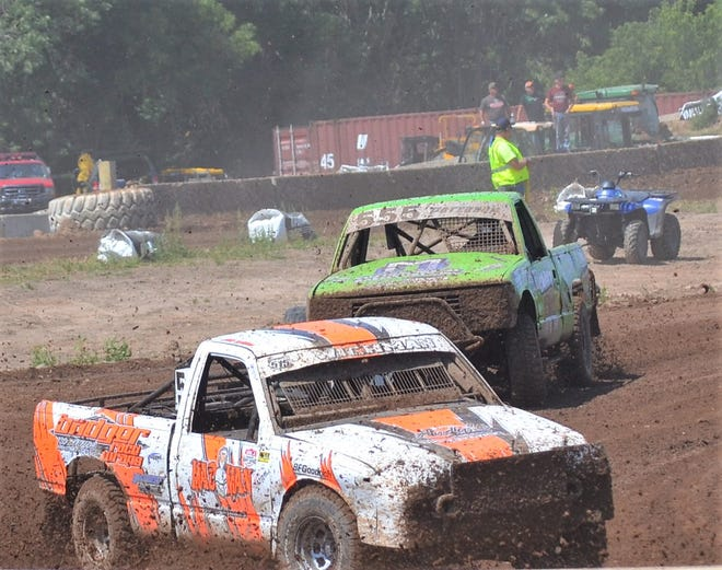 Racers in the mod carts division make a turn Sunday in the Dirt City Duel off-road races at Lena.
