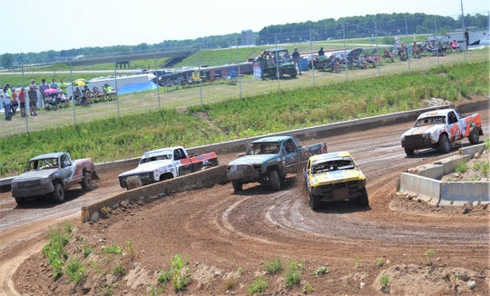 Mod carts division  races enter the the split turn section of Dirt City Motoplex track Sunday during the Dirt City Duel at Lena on Sunday.  The turn leads to two lanes, one of several feature of the track to challenge drivers and entertain spectators.