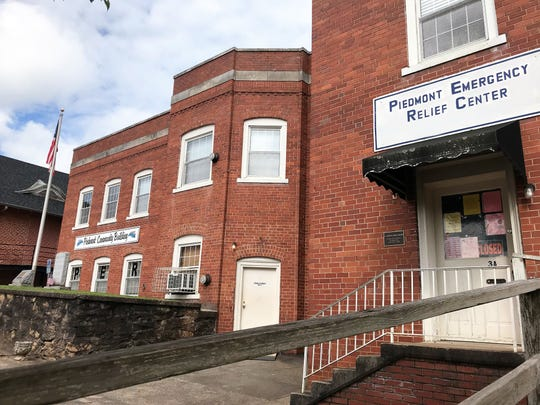 Shown here in a June 12, 2019, photo, the Piedmont Community Building is the most substantial physical remnant of the once sprawling textile operations in the mill village that sits on the banks of the Saluda River in Greenville and Anderson counties. As of July 2019, the Piedmont Public Service Commission was in negotiations to sell a small lot behind this building as part of a planned redevelopment of 11.5 acres where  Piedmont Mill One once stood.