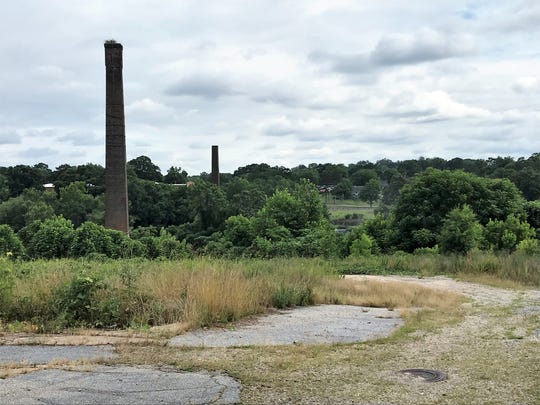 Smokestacks rise above a field of kudzu on June 12, 2019, at the site of the old Piedmont Mill One on the Saluda River in Greenville County. A Greenville developer recently announced he plans to build a commercial and residential development on the site, which has say empty since the mill burned and was torn down in 1983.