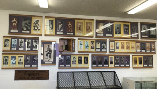 The Duane Olson Memorial Wall of Champions, dedicated to the Pioneer wrestling champions, sits inside the entrance to the Big Sandy High School gym.