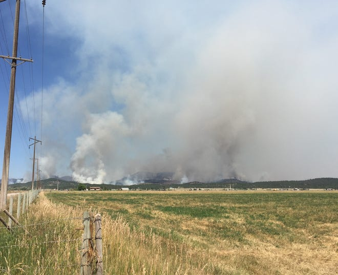 The North Hills Fire north of Helena was threatening 600 homes earlier this week. Some residents in the area were allowed to return home on Wednesday.