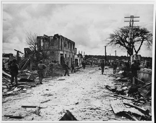 Marines enter the ruins of Agana on July 31, 1944