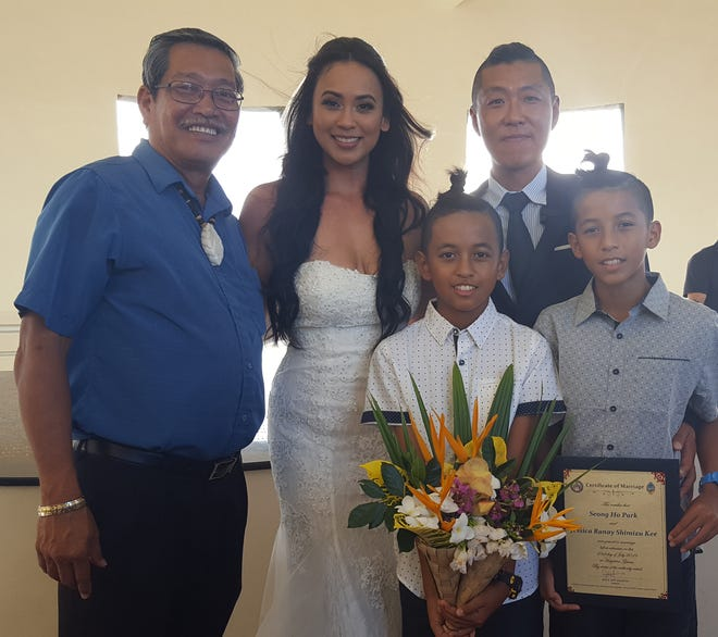 Seong Ho Park and Jessica Shimizu Kee were married July 23 at the Latte of Freedom in Adelup by Sen. Joe S. San Agustin. From left: San Agustin, Kee, Zachariah Shimizu, Park and Jack Shimizu.