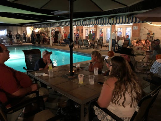 Nashville songwriters along with Sandy Lee Songfest sponsors, volunteers and friends pack the pool deck and party house for the after-party and fish fry Saturday night at Red Dog Central, the Songfest's nickname for the home of Roger and Linda Meuth.
