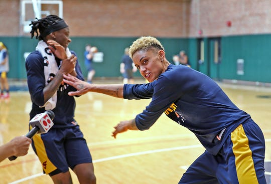 Indiana Fever's Candice Dupree, right, jokes around Monday by pushing Erica Wheeler out of the way so she can talk with the media at Bankers Life Fieldhouse.
